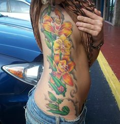 Orange and Yellow Orchids Tattoo by Isaac Davis...   I like the yellow orchid in the center...