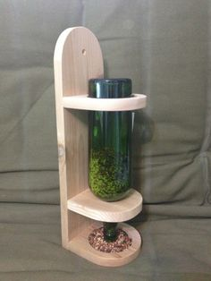 Wine bottle bird feeder by TwoShusWoodcrafts on Etsy, $14.00