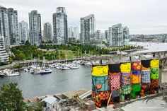 Two Brazilian graffiti artists, Os Gemeos, recently decorated some industrial silos in Vancouver with giant illustrations. They painted their signature yellow cartoonish characters to give some life to a very grey area of the city.