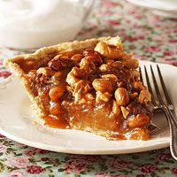Honey Nut Crunch Pie Recipe ~ A sticky-sweet honey filling and butterscotch-nut topping turn a simple pastry crust into a luscious dessert your family will love. Be careful: With a sweet-yet-nutty dessert like this, your family may have found a new favorite.