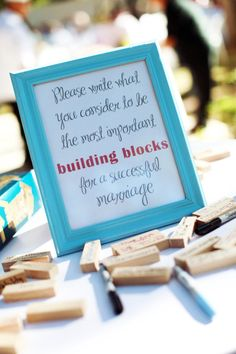 """Have guests write """"the building blocks for a successful marriage"""" on Jenga blocks"""