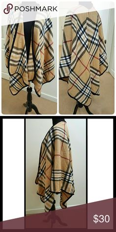 Striped Blanket Scarf Soft blanket scarf, faux burberry print striped tan, ivory, black and red colors w black trim. No tag, but feels like a lightweight wool. Front hits just above knee, back is longer and hits below knee. New wo tag Jackets & Coats