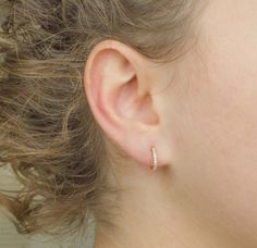 These tiny gold hoops are the essential everyday piece you put in and never take out . Delicately beautiful & a must have, one of our favorite ear accessory. Very simple and yet so elegant! Easy to wear and combine with plenty other dainty earrings. The tiny zirconia stones will allow the light to create a subtle sparkle.  Details:  Price shown is for a PAIR. 12mm hoops. All our pieces are 18K gold plated on 925 sterling silver.    ◾️◾️◾️Click here to visit my shop…
