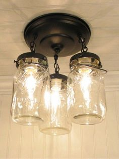 Vintage Mason Jar Ceiling Light Trio - this would be fun to do for outdoor lighting - or expand it into a cool chandelier or something