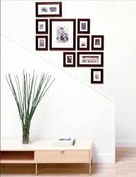The Picture Wall Company picture frame arrangement going up the stairs Frames On Wall, Wall Collage, Art Frames, Picture Frames On The Wall Stairs, Wall Art, Art Walls, Wall Photos, Picture Frame Arrangements, Photo Arrangement