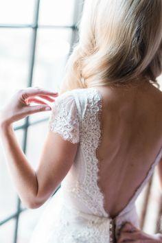 Low back lace wedding dress:  http://www.stylemepretty.com/new-york-weddings/new-york-city/2016/05/23/designer-dress-a-list-florist-celebrity-photographer-this-manhattan-wedding-is-a-must-see/   Photography: Trent Bailey Studios - http://www.trentbailey.com/