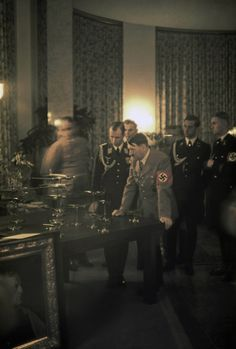 OK, here we go: a blurry Albert Speer on the left (wonderful effect here), Von Below, Adolf Hitler (unshaven… sheesh)… Karl Brandt and… unknown. Neither of these unknown guys are Max, but they resemble him. 1939. (via putschgirl)