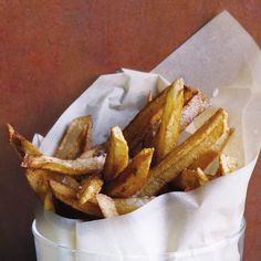 The trick to french fries is double-frying.          First, flash-fry the potatoes to eliminate moisture, then fry them again to ensure crispness. Eating them with mayonnaise will take you to Europe.