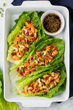 I definitely have a thing for lettuce wraps lately. I shared these Thai Chicken Lettuce Wraps and this Almond Poppy Seed Chicken Salad (which I served lett