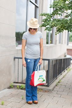 Vacation Style, fedora, flare jeans, gray tee, wedges, leather earrings