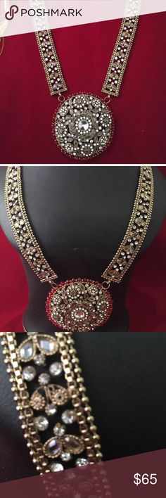NWOT long necklace Beautiful  mate gold polki  kundan  long necklace attached  with rhinestones and stones and red crystal beads  . Please ask as many as questions before buying it's a final sell  no Return or Exchange accepted.Thank you Jewelry Necklaces
