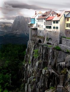 While the cliffside village of Ronda, Spain DOES exist this photo is NOT real, it is a Photoshopped image. Click the link for real photos of Ronda, Spain. Places Around The World, Oh The Places You'll Go, Places To Travel, Places To Visit, Around The Worlds, Travel Destinations, Wonderful Places, Beautiful Places, Simply Beautiful