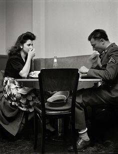 May 1942. A corporal in the Army takes his girl to dinner. Bakersfield, California.