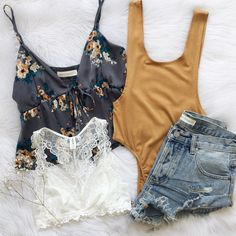 summer outfit - jean shorts with a tan body suit, white lace bralette and navy floral print tank