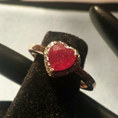 Amazing Niassa Ruby Heart cut 1.60ct ring. New Heart shape Niassa Ruby with Diamonds .02cts. The band is 14k Rose Gold and Platinum over Sterling Silver. Jewelry Rings