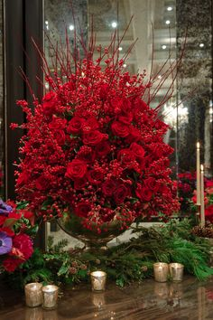 stunning Christmas Ilex and Red Rose arrangement