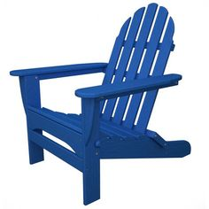 A classic adirondack chair in a brilliant blue brightens up an outdoor space. | $320