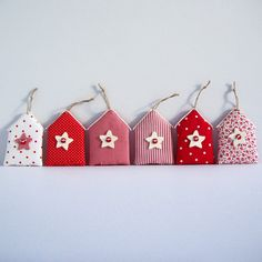 Ornaments from fabric, shaped house in 6 different shades of red, with stars decoration. Different Shades Of Red, Star Decorations, Shapes, Drop Earrings, Ornaments, Holiday Decor, Fabric, Christmas, Handmade
