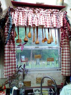 Country kitchen window ~ Love the mashers hanging from the curtain rod...