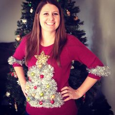 DIY ugly christmas sweater. Tinsel, plastic ornaments ($1 at target), jingle bells, star ornament ($1 at michaels) and some hot glue