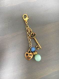 A personal favorite from my Etsy shop https://www.etsy.com/listing/494448876/gold-key-and-heart-cat-lovers-charm