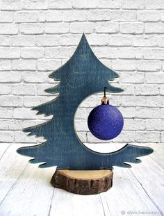 Buy and order Christmas tree table with a blue ball on Livemaster online shop. Shipped over Russia and the CIS. Production time: <br />. Materials: plywood 8 mm. Dimensions: 225х255 mm <br />