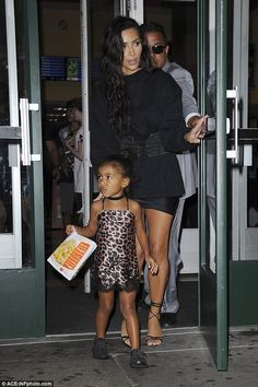Treat: North held a bag of popcorn as the family visited an AMC theater in Manhatan