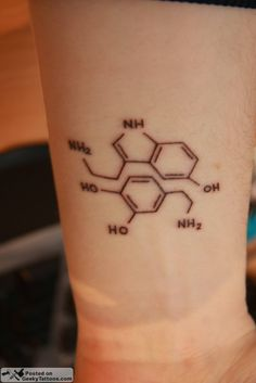 This is a tattoo of dopamine and serotonin molecules. Neat.