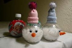 Holiday Pop Bottle Craft Cleaning off the label - Filling them with craft snow - Hot glue lid back on - Glue googly eyes - Glue pipe cleaner nose - Cutting a baby sock at around the heal and gathering it, then glue a little pom pom on top Snowman Crafts, Holiday Crafts, Fun Crafts, Crafts For Kids, Pop Bottle Crafts, Plastic Bottle Crafts, Christmas Holidays, Christmas Bulbs, Christmas Decorations