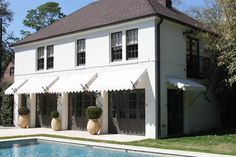 awnings & doors- this would make an awesome pool house/guest house