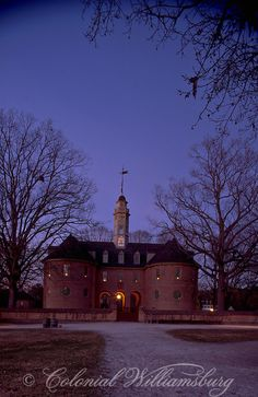 The Capitol at dusk with candles in windows for Christmas, Colonial Williamsburg. Photo by David M. Doody.