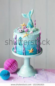 Mermaid Birthday Cake Decorated Seashells Stock Photo (Edit Now) 1523361923 Ocean Birthday Cakes, Little Mermaid Birthday Cake, Ocean Cakes, Little Mermaid Cakes, Cute Birthday Cakes, Fondant Birthday Cakes, Birthday Cake For Kids, Rapunzel Birthday Cake, Beautiful Birthday Cakes