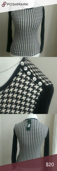 "Ralph Lauren Houndstooth Top Black and white knit houndstooth top. 5 silver buttons detail the left shoulder. 15""bust 21""L  22"" sleeve. Does have stretch.  100% cotton Lauren Ralph Lauren Tops Blouses"