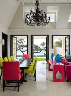 Before you take a look at the neon combination here of pink, blue and yellow and say OMG no way...look at how well it blends with the neutral and formal room. It may not be for everyone, but imagine the fun of decorating this room at Christmas. Bright, fun colors for sure!