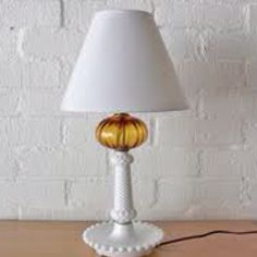 I have this antique amber glass & hobnail milk glass lamp. It belonged to my grandmother.