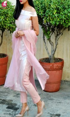 Buy Baby Pink Metallic Padded Pure Crepe Kurti with Baby Pink Cotton Silk Pants and Baby Pink Pure Organza Ruffle Stole Kurti Set Online in India Indian Fashion Dresses, Indian Bridal Outfits, Indian Gowns Dresses, Dress Indian Style, Fashion Outfits, Simple Kurta Designs, Kurta Neck Design, Indian Designer Suits, Kurti Designs Party Wear