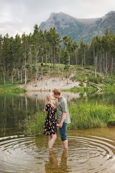 Summer Engagement Session - Red Lodge - Mountains - Trees - Sunset - Lake - Water - Ripple - Kissing - Fiance - Engaged Couple - Green Shirt - Olive Shirt - Jeans - Black Floral Dress - Montana Wedding Photographer - Sara Nagel Photography Engagement Photography, Engagement Session, Engagement Photos, Olive Shirt, Sunset Lake, Red Lodge, Montana Wedding, Lake Water, How To Pose
