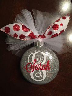 Monogram glitter Christmas ornament. Pledge floor polish, extra fine glitter, vinyl monogram, tulle bow. #silhouettecameo #diy #glitterornament