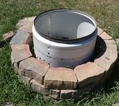 Homemade fire pit. Used dryer drum, dig a whole in ground