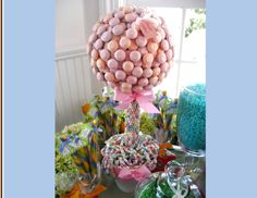 food topiary centerpieces   love how the candy necklaces are incorporated into this one.