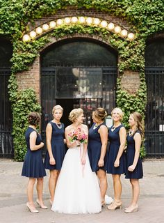 Sweet chic navy bridesmaids Photography: O'Malley Photographers - www.omalleyphotographers.com