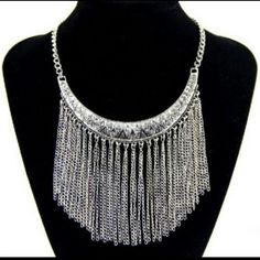 Crescent Tassel Statement Necklace Amazing silver tone bib necklace with tassels dangling from Crescent. New in pkg. Length approx: 440mm,50mm,adjustable. Pendant size approx: 90*110mm.  #crescentnecklace #tassels #silvertassels #jewelrysale #fashionjewelry #fashionsale Boutique  Jewelry Necklaces