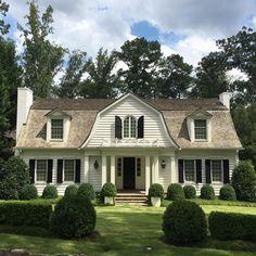 Limestone & Boxwoods - Instagram (@limestonebox) - A lush landscape at a house designed by Stan Dixon in Atlanta.