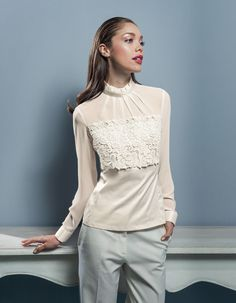 A wonderful blouse of NaraCamicie with a beautiful lace front.