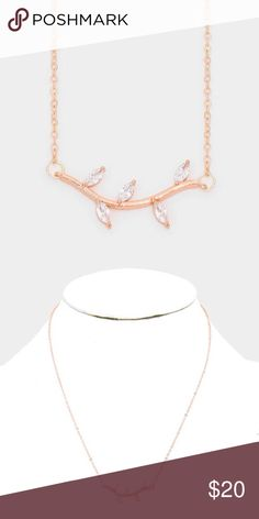 """Austrian leaf twig pendant necklace Measures 17"""" by 3"""" L with a pendant measuring 0.5"""". The colors are rose gold and clear. Made of brass and silver alloy. Lead and nickel compliant. Smoke free, cat friendly home. Photos courtesy of Farah Jewelry. Farah Jewelry Jewelry Necklaces"""