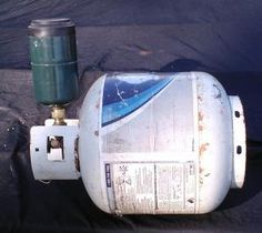 How to refill your used 1 pound propane canisters from a larger tank. Safety tips and other useful information from Backdoor Survival.