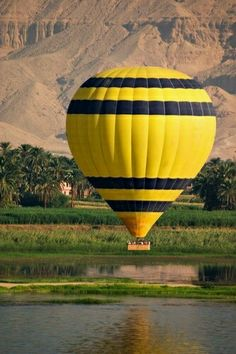 A hot air balloon over the River Nile at Luxor. We did it at sunrise, incredible, if in Luxor, do it! Air Ballon, Hot Air Balloon, Big Balloons, Visit Egypt, Nile River, Balloon Rides, Egypt Travel, Over The River, Paragliding
