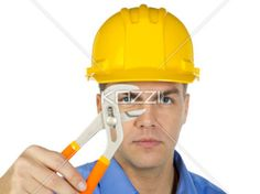 manual worker with a wrench. - Portrait image of a manual worker wearing hard hat and holding a wrench. Model: Denis Bryzgounov
