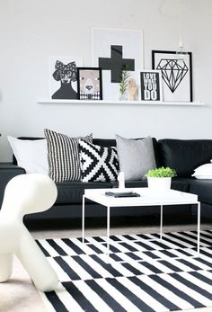 Too much black & white...rug / couch & pillows / art is over the top