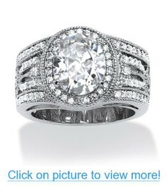 4.47 TCW Oval-Cut Cubic Zirconia Engagement/Anniversary Ring in Platinum Over Sterling Silver